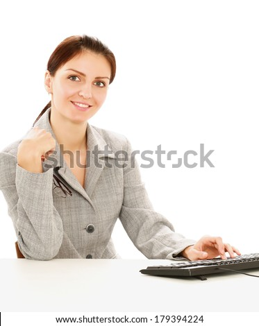 Young businesswoman sitting on the desk. Isolated on white background - stock photo