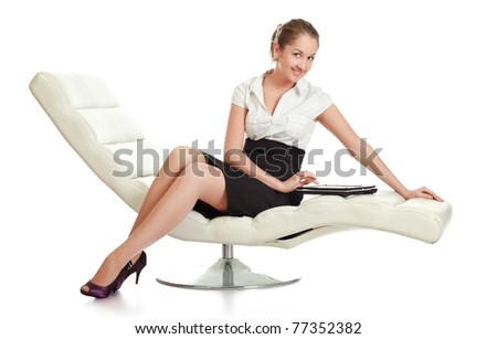 young businesswoman sitting with laptop, isolated on white