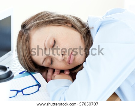 Young businesswoman sleeping in the office