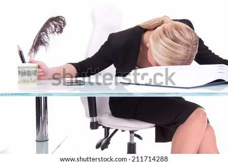 Young businesswoman sleeping on desk. beautiful young woman holding feather - stock photo