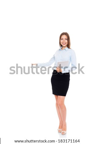 young businesswoman smile hold open palm with empty copy space, business woman showing hand sign to side, concept of advertisement product, full length portrait isolated over white background - stock photo