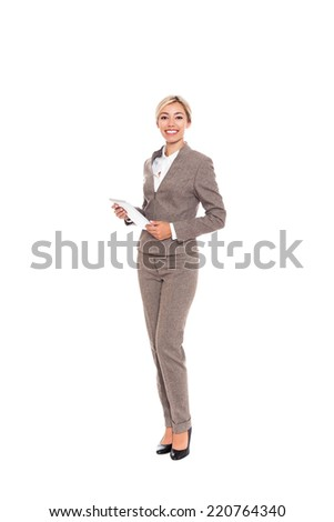 Young businesswoman smile hold tablet computer, attractive business woman, full length portrait isolated over white background - stock photo