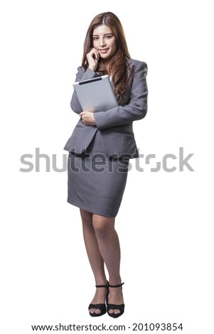 Young businesswoman standing holding digital tablet isolated on white background. Beautiful mixed race Asian with finger on touch screen display - stock photo
