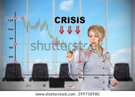 young businesswoman standing in office and drawing crisis chart - stock photo