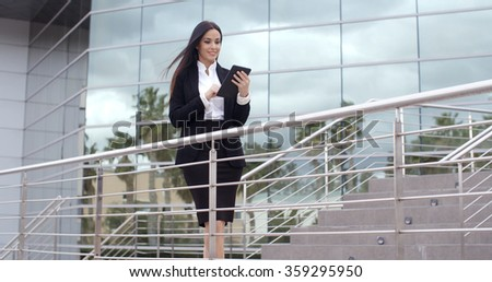 Young businesswoman standing on a concourse