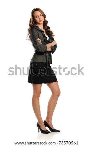 Young Businesswoman standing with her arms crossed isolated on a white background