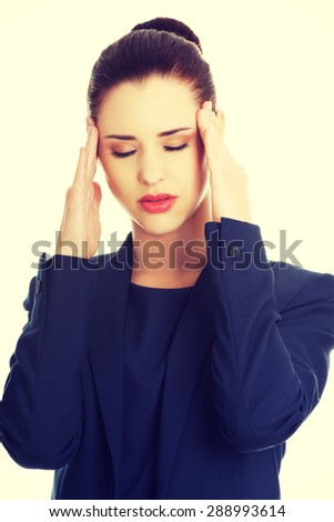 Young businesswoman suffering a headache - stock photo