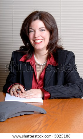 Young Businesswoman Taking Part In A Conference Call