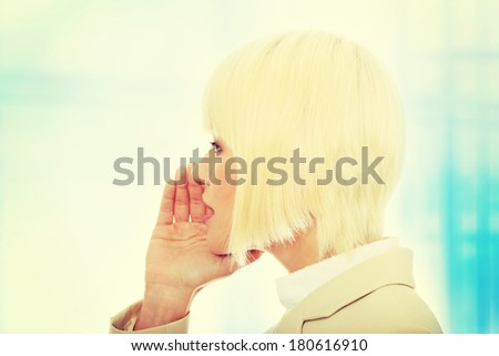 Young businesswoman talking gossip,Over abstract blue background  - stock photo