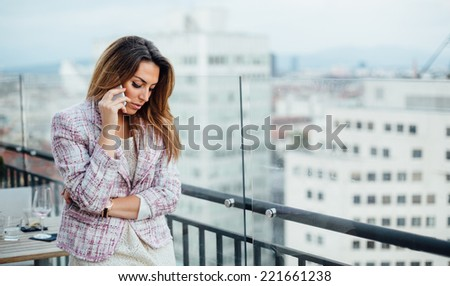 Young businesswoman talking on phone in cafe - stock photo