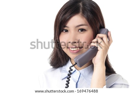 Young businesswoman talking on the phone at work-close up - stock photo