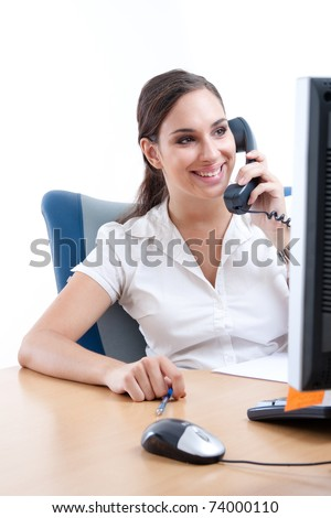 Young businesswoman talking on the phone in her office
