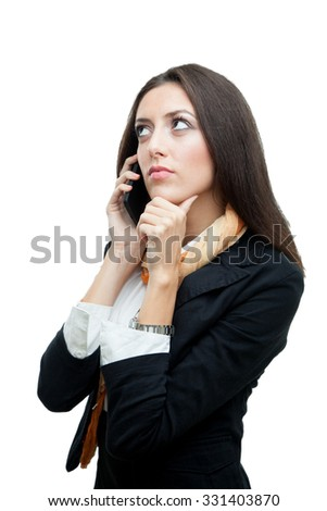 Young businesswoman talking over her phone, isolated on white - stock photo