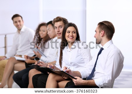 Young businesswoman talking to colleague at the office meeting