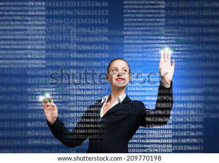Young businesswoman touching icon of media screen - stock photo