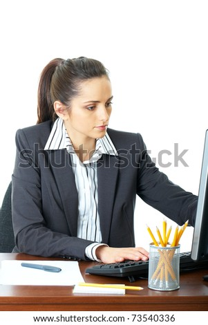 young businesswoman type something on keyboard while checking monitor in front of her, isolated on white - stock photo