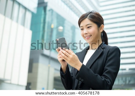 Young Businesswoman use of mobile phone