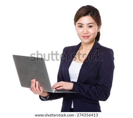 Young businesswoman use of notebook