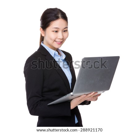 Young businesswoman use of notebook computer - stock photo