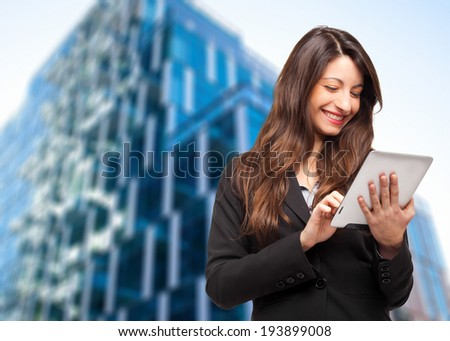 Young businesswoman using a tablet outdoor  - stock photo