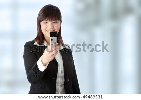 Young businesswoman using cell phone - stock photo