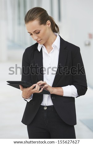 Young businesswoman using digital tablet