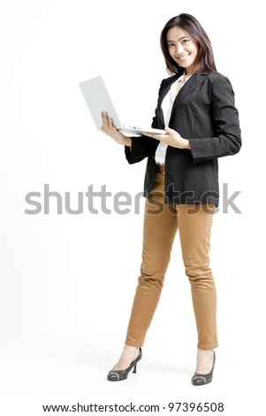 Young businesswoman using her laptop - stock photo