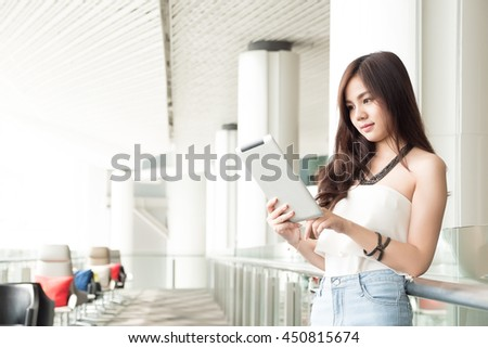 young businesswoman using tablet - stock photo