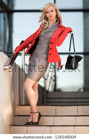 Young businesswoman walking on the city street - stock photo