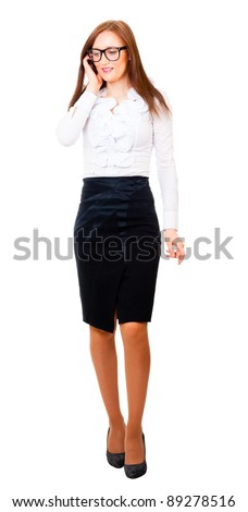 Young businesswoman walks and talking on cell phone isolated over white background - stock photo