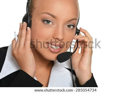 Young businesswoman wearing headphones working on a white background
