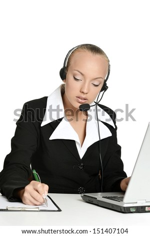 Young businesswoman wearing headphones working with a computer