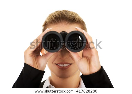 Young businesswoman with a binocular