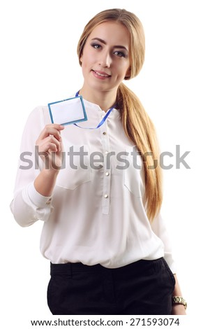Young businesswoman with a blank business badge isolated on white - stock photo