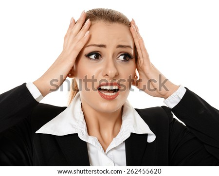 Young businesswoman with a shock expression, having just gotten the nastiest surprise of her life - stock photo