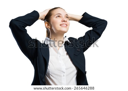 Young businesswoman with arms behind head isolated on white - stock photo