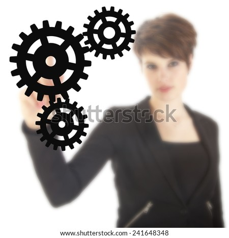 Young businesswoman with black gears isolated on white background - stock photo