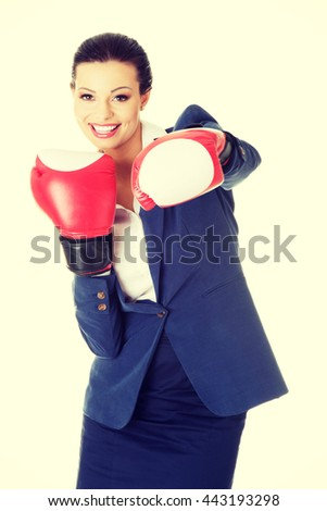 Young businesswoman with boxing gloves