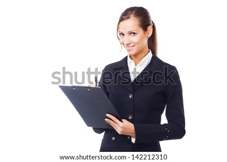 Young businesswoman with clipboard against white background