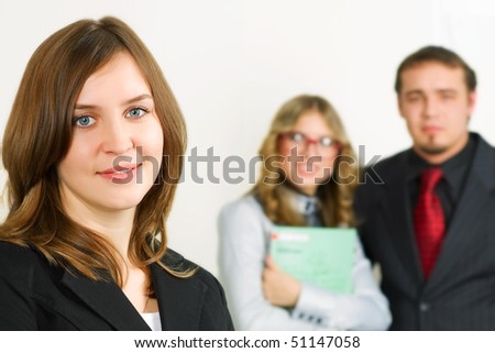Young businesswoman with colleagues.