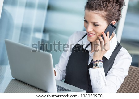 Young Businesswoman with Computer and Mobile Phone - stock photo