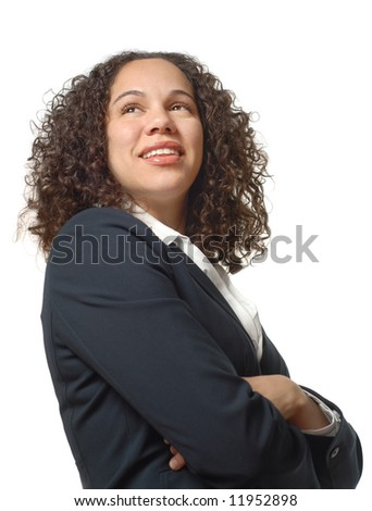 Young businesswoman with crossed arms beaming with pride - stock photo