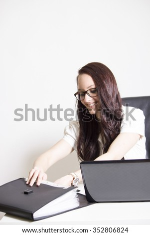 Young businesswoman with glass