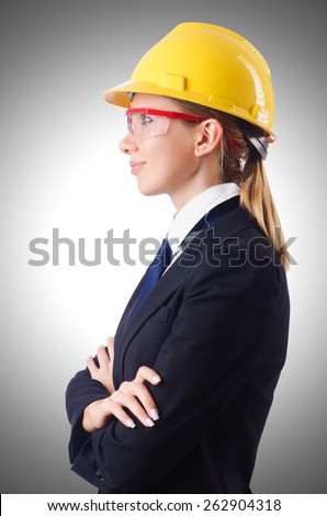 Young businesswoman with hard hat on white - stock photo