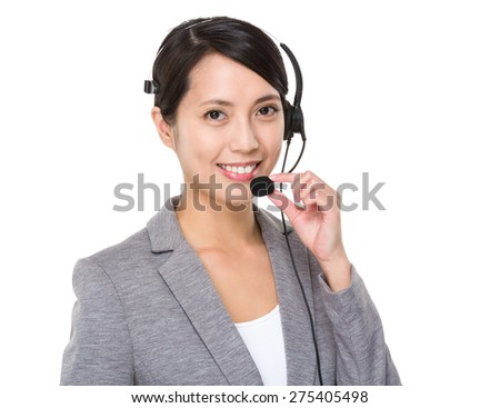Young businesswoman with headset - stock photo