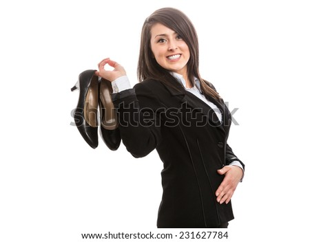 Young businesswoman with high heels after work - stock photo
