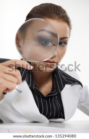 Young businesswoman  with magnifying glass