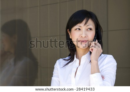 young businesswoman with mobile phone, outside
