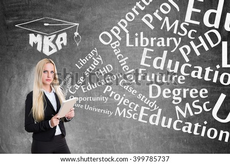 Young businesswoman with notebook, education words flying from it. Black background. Concept of  business studying.