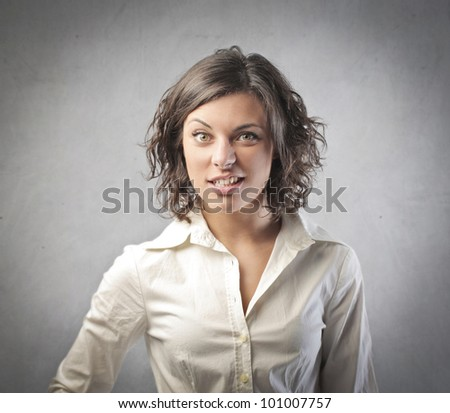 Young businesswoman with perplexed expression